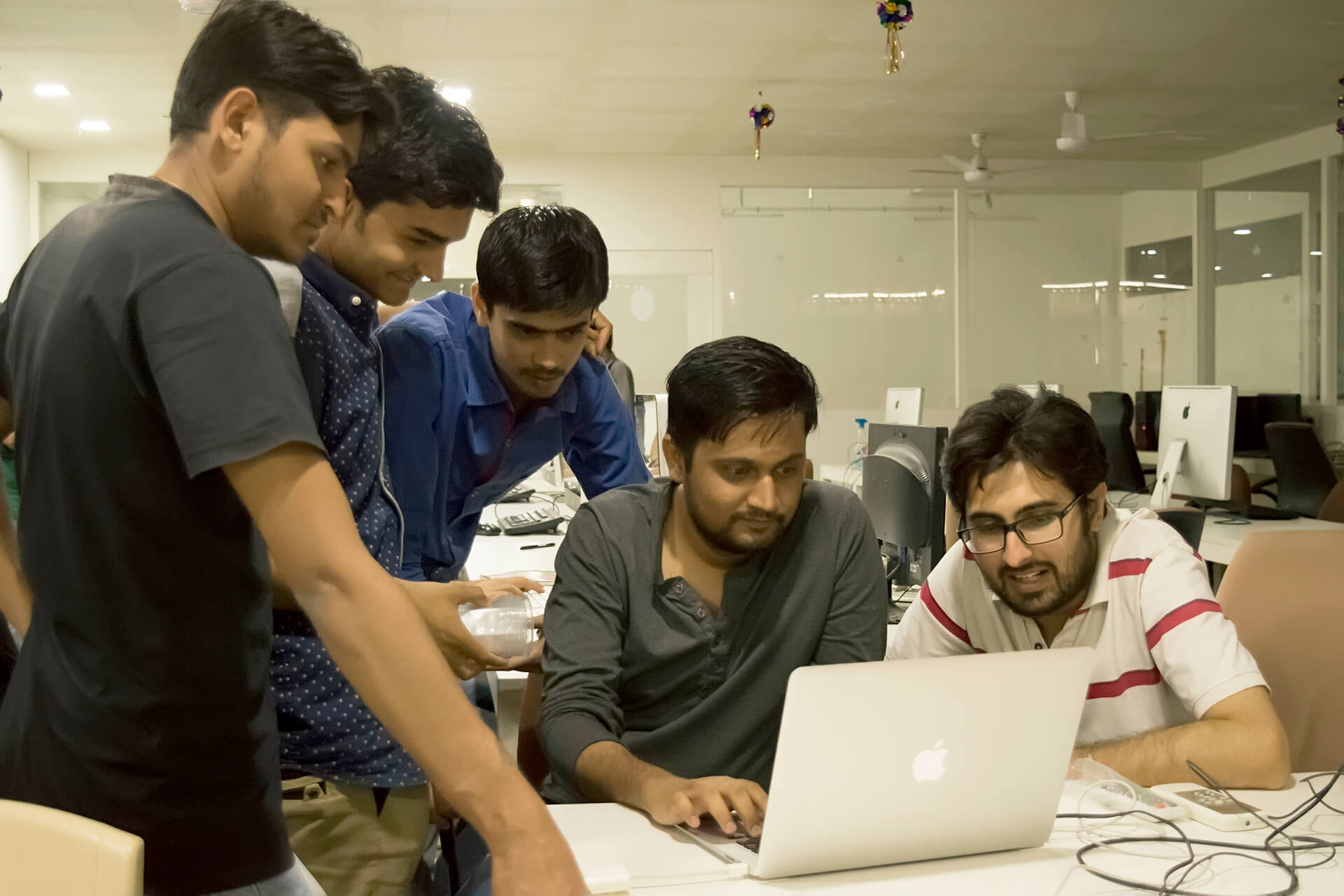 Team members discussioning about Snakes and Ladders 3D mobile game at TheAppGuruz